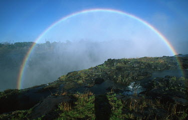 Clear rainbow over Victoria Falls - Zimbabwe Aerial,Waterfall,Spectacular,Light,Mist,Spray,Landscape,Formation,Geological,Water,River,Cliff,Rainbow