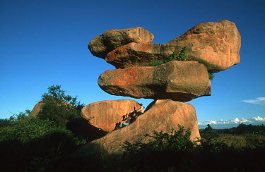 Tourists sitting on balancing rocks - Harare, Zimbabwe Tourist,Rock formation,Path,Viewing,Ancient,Natural