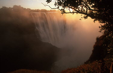 Victoria Falls at sunrise - Zimbabwe Waterfall,Spectacular,Sunrise,Light,Mist,Spray,Landscape,Formation,Geological,Water,River,Cliff