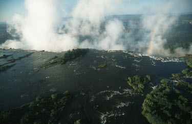 Aerial view of Victoria Falls - Zimbabwe Aerial,Waterfall,Spectacular,Light,Mist,Spray,Landscape,Formation,Geological,Water,River,Cliff,Rainbow