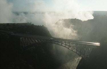 Aerial view of Victoria Falls bridge - Zimbabwe Aerial,Waterfall,Spectacular,Light,Mist,Spray,Landscape,Formation,Geological,Water,River,Cliff,Bridge
