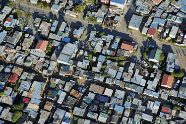 Aerial view of an informal settlement on the Cape Flats - Western Cape Province, South Africa Aerial,Informal settlement,Improvisation,Roofs,Rooftops,Colourful,Environment,Outside,Pattern,Order,Blocks,Square
