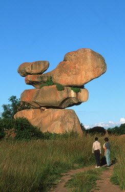 Balancing rocks with tourists looking up - Harare, Zimbabwe Tourist,Rock formation,Path,Viewing,Ancient,Natural