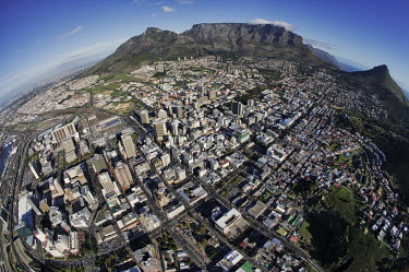 Aerial view of Cape Town with Table Mountain, Devil�s Peak and Lion�s Head in the background - Western Cape Province, South Africa Aerial,Fish-eye,Skyline,City,High-rise,Pattern,Order,Block,Mountain,Table Mountain,Urban sprawl,Tarmac,Road