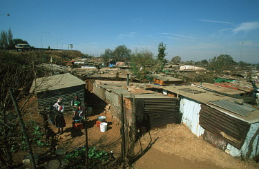 View of informal settlement/slum area - Johannesburg, South Africa Aerial,Informal settlement,Improvisation,Roofs,Rooftops,Colourful,Environment,Outside