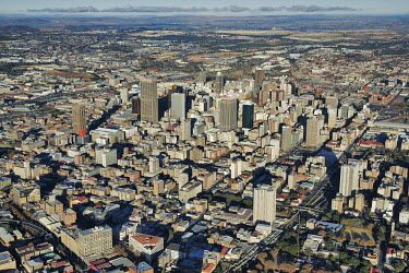 Aerial view of Johannesburg city centre with highrise buildings in the background - Gauteng Province, South Africa Aerial,Skyline,City,High-rise,Pattern,Order,Block,Mountain,Urban sprawl,Tarmac,Road,Suburb