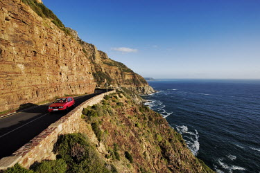 Aerial view of Chapman�s Peak Drive, steep cliffs fall into the Atlantic Ocean right next to the scenic drive - Western Cape Province, South Africa Coast,Road,Winding,Car,Rocky,Cliff,Mountain,Hills,Ocean,Sea