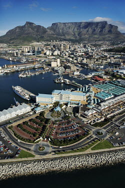 Aerial view of the Victoria & Alfred Waterfront with Table Mountain and Devil's Peak in the background - Cape Town, South Africa Aerial,Landscape,Harbour,Working port,Industry,Land management,Sea,Ocean,City,Boats,Table Mountain,Mountains,Skyline