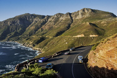 Aerial view of Chapman�s Peak Drive, steep cliffs fall into the Atlantic Ocean right next to the scenic drive - Western Cape Province, South Africa Coast,Road,Winding,Car,Rocky,Cliff,Mountain,Hills,Ocean,Sea,Viewpoint