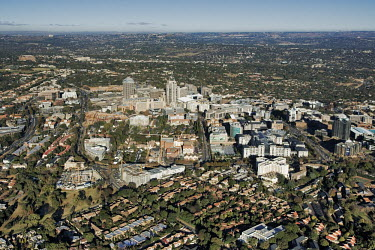 Aerial view of Sandton City and the Michelangelo Towers - Gauteng Province, South Africa Aerial,Skyline,City,High-rise,Pattern,Order,Block,Mountain,Tarmac,Road,Suburb,Towers,Tree-lined