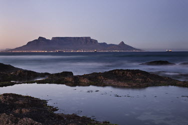 Table Mountain at sunrise - South Africa Table Mountain,Iconic,Landscape,Sunrise,Lights,Bay,Ocean,Rocky shore,Long exposure,View