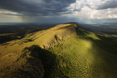 Aerial view of the Magaliesburg mountains with stormclouds overhead - South Africa Storm clouds,Rain,Storm,Dark sky,Grey,Sunbeam,Mountain,Mountain range