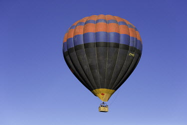 Hot air balloon against a clear blue sky - South Africa Hot-air balloon,Lake,Flying,Ride,Calm,Blue sky,Clear sky,Mountains,Entertainment,Activity,Excursion,View,Colourful,High up