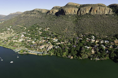 Riverside town backed by high ridges - South Africa Aerial,Riverside,Town,Mountains,Settlement,Slope,River,Boats,Trees