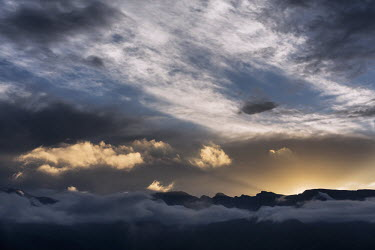 The Amphitheatre mountain range at sunrise - South Africa Mountain,Sunrise,Cloud,Colour,Morning,Dramatic,Sunbeam