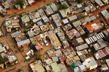 Aerial view of an informal settlement - South Africa Aerial,Informal settlement,Improvisation,Roofs,Rooftops,Colourful,Environment,Outside,Road