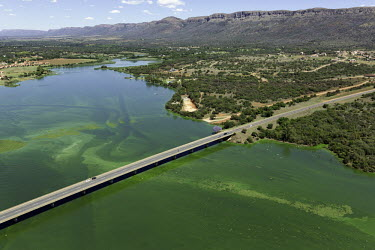 Aerial view of river and bridge - South Africa Aerial,Traffic,Management,Bridge,River,Landscape,Mountains,Settlement,Algae