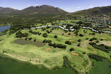 Aerial view of a riverside golf course - South Africa Aerial,Riverside,Mountains,Settlement,Slope,River,Trees,Landscape,Golf Course,Land management,Leisure,Activities,Land conflict