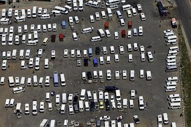 Aerial view of a car-park - South Africa Aerial,Carpark,Order,Lines,Tarmac,Transport,Modern,Car,bus,Travel