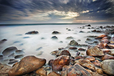 Dramatic clouds over a rocky bay, long exposure - South Africa. Beauty in nature,Rocky shore,Stones,Pebbles,Coastal,Coast,Sea,Ocean,Long exposure,Cloud formation,Dramatic sky