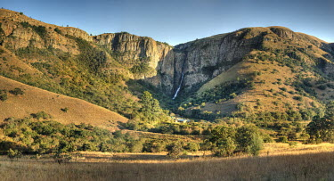 A View of a waterfall down a canyon - South Africa Viewpoint,View,Cliff,Canyon,Boulder,Narrow,Landscape,Formation,Mist,Adventure,River,Trees,Waterfall,Cascade,Powerful,Vegetation,Lowland,Plain