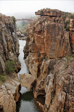 View of a bridge through a canyon - South Africa Viewpoint,View,Bridge,Cliff,Canyon,Boulder,Narrow,Landscape,Formation,Mist,Adventure