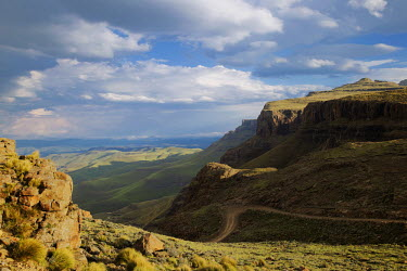 A clear view from the Sani pass road - uKhahlamba Drakensberg Park, South Africa no people,horizontal,day,front view,Africa,African,Southern Africa,scenic,scenery,beauty in nature,natural world,non-urban scene,nature,outdoors,Road,Winding,Cliff,Valley,Landscape