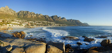 View of Camps Bay with the view of the Twelve Apostles mountain range - Cape Town, South Africa Aerial,Coastal,Town,Beach,Sand,Mountain,Cliff,Settlement,Civilisation,Ocean,Sea,Bluesky