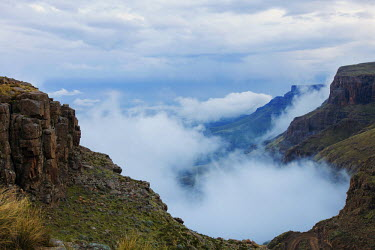 The view from the Sani pass road with low clouds - uKhahlamba Drakensberg Park, South Africa no people,horizontal,day,front view,Africa,African,Southern Africa,scenic,scenery,beauty in nature,natural world,non-urban scene,nature,outdoors,Low cloud,Cloud formation,Valley,Rock formation,Landsca