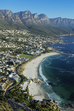 Aerial view of Camps Bay with the view of the Twelve Apostles mountain range - Cape Town, South Africa Coastal,Town,Beach,Sand,Mountain,Cliff,Settlement,Civilisation,Ocean,Sea,Bluesky