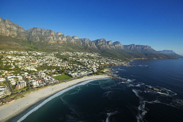 Aerial view of Camps Bay with the view of the Twelve Apostles mountain range - Cape Town, South Africa Aerial,Coastal,Town,Beach,Sand,Mountain,Cliff,Settlement,Civilisation,Ocean,Sea,Bluesky,Rock formation